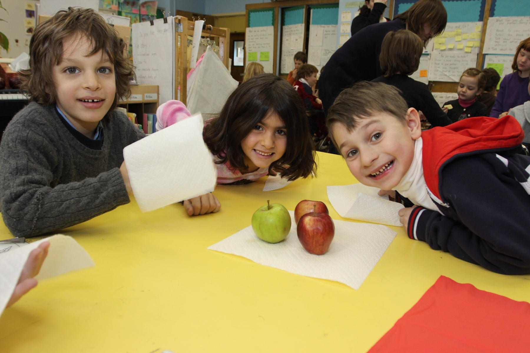 3 children with apple at Take a Taste