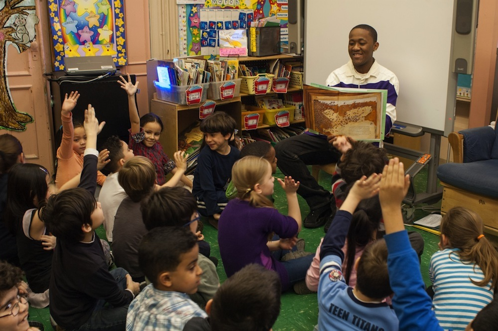 High School students from Abraham Lincoln High School read to 2nd graders at PS 102 in Bay Ridge, Brooklyn.