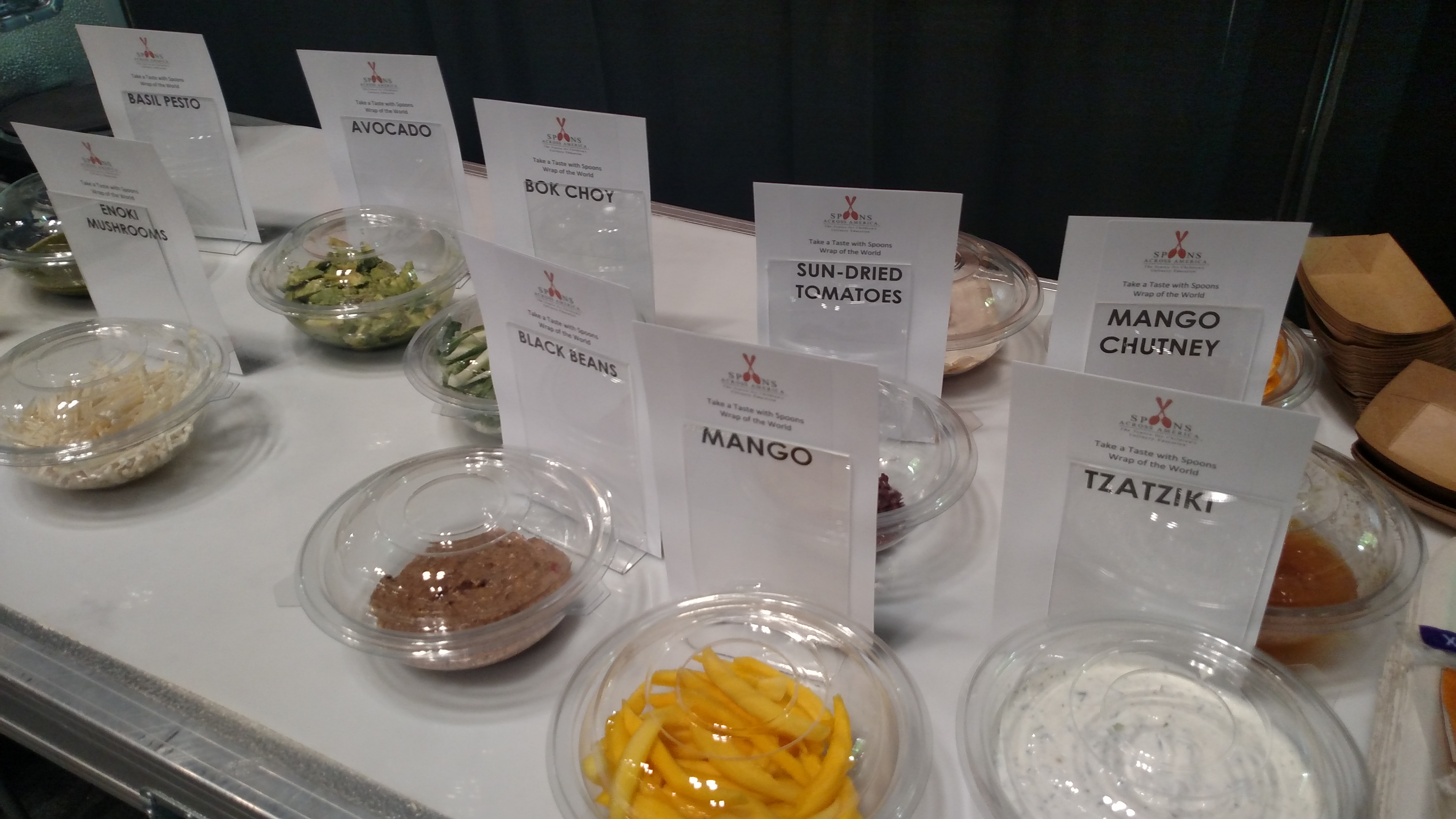 """Children got to taste lots of different foods at a Spoons Across America program at """"Taste of the World: Kid's Kitchen"""" at the New York Times Travel Show this past winter."""