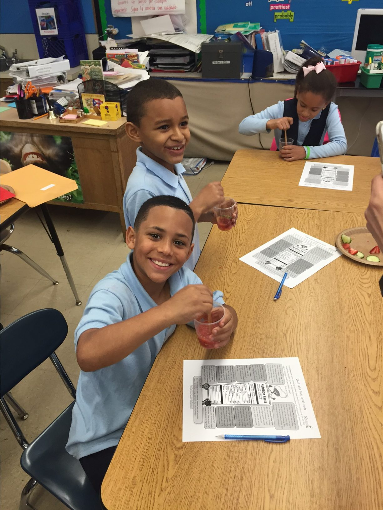 Third graders mix up a fizzy fruit beverage -- no sugar needed -- after learning to read a nutrition facts label.