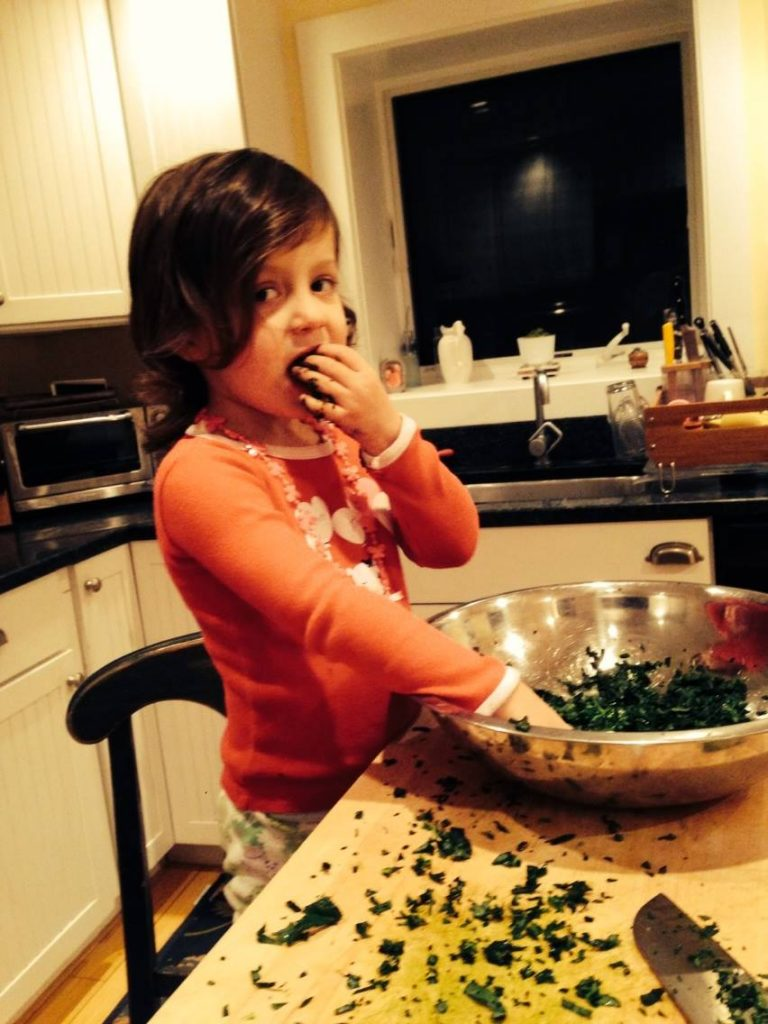 Eating kale while we cook at home